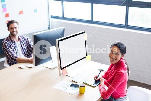 Colleagues at desk in creative office