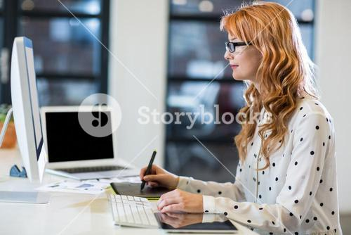 Businesswoman working in creative office