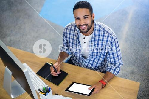 Businessman using digital tablets in office