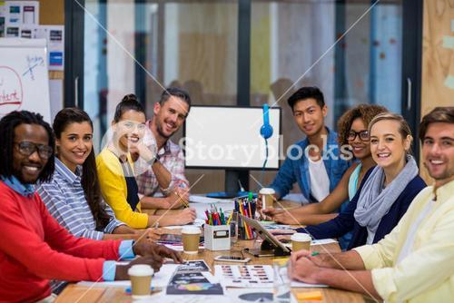 Young colleagues in meeting room