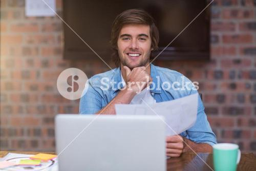 Businessman holding document in office