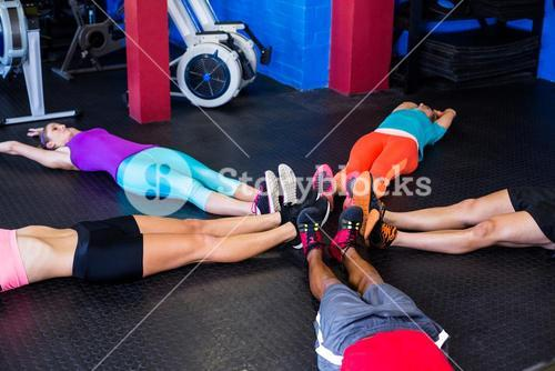 People stretching in gym