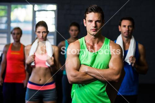 Portrait of serious friends in gym