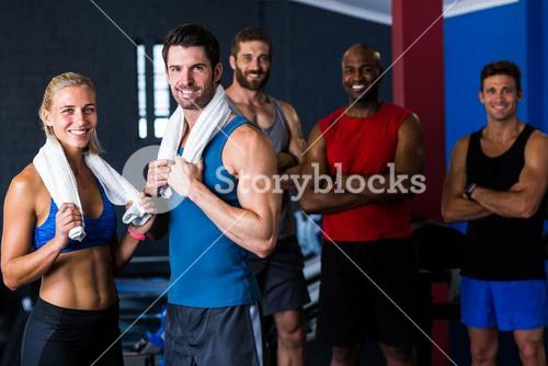 Portrait of happy multi-ethnic friends in gym