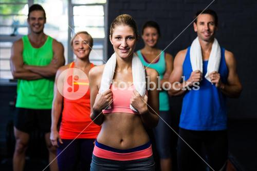 Portrait of happy fit friends in gym