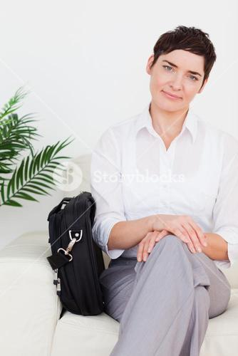 Smirking Businesswoman with a bag
