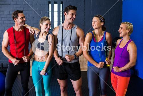 Male and female athletes with jump rope