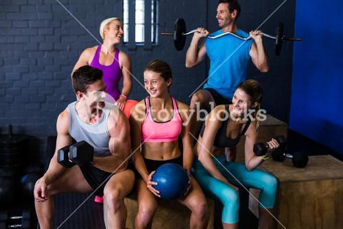 Happy athletes with exercise equipment