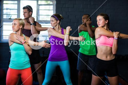 Athletes exercising in fitness studio