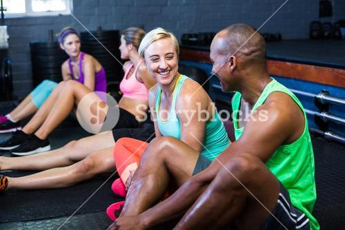 Athletes smiling while talking in fitness studio