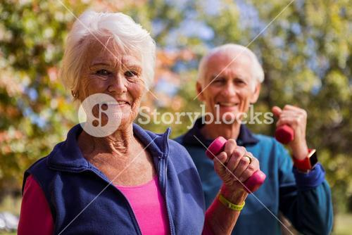 Elderly couple making fitness and lifting hand weight