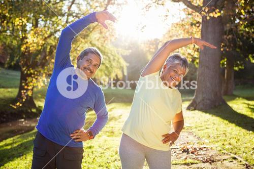 Mature couple exercising at park