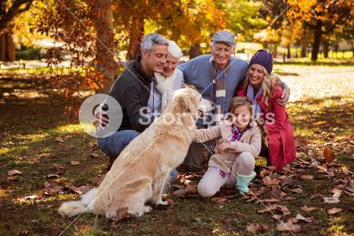 Smiling family with their dog
