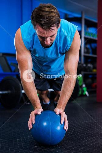 Male athlete with ball in gym
