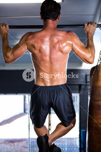 Rear view of athlete doing chin-ups