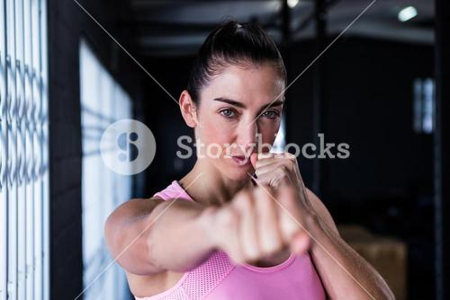 Portrait of confident athlete punching