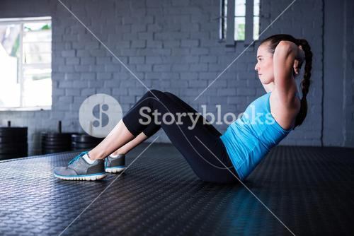 Side view of sporty athlete in gym