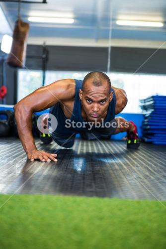 Determined man doing push-ups