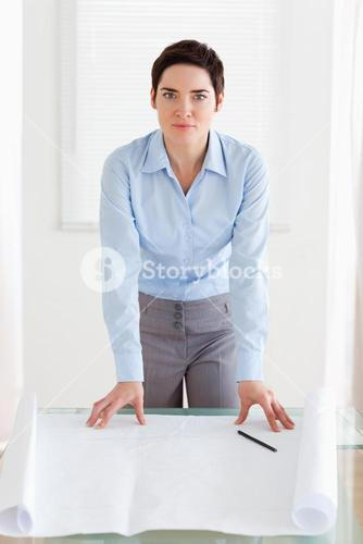 Businesswoman with a architectural plan