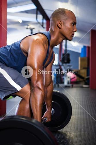 Male athlete lifting barbell