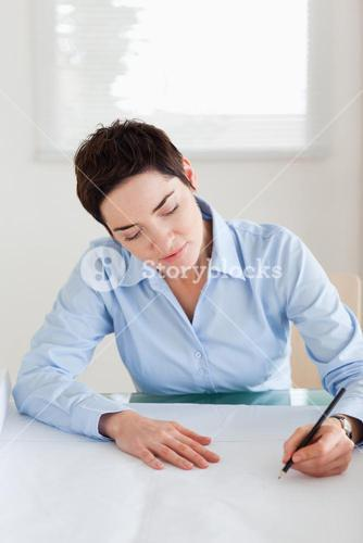 Charming woman with a architectural plan
