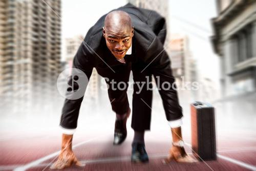 Composite image of businessman in the starting blocks