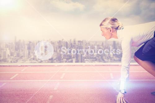 Composite image of businesswoman in the starting blocks
