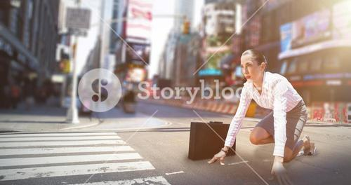 Composite image of businesswoman in starting blocks
