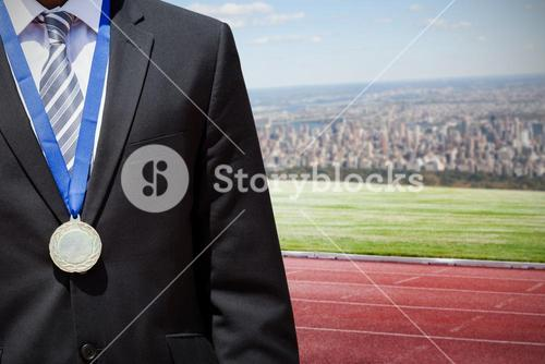 Composite image of close up of businessman chest with medal