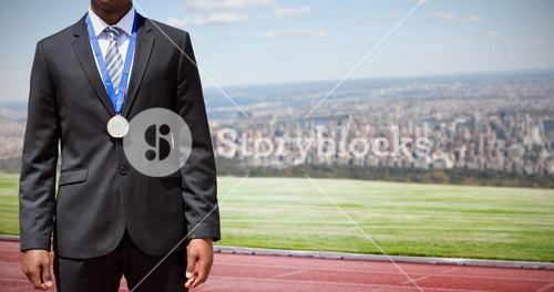Composite image of businessman with medal