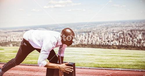 Composite image of close up of businessman in starting blocks