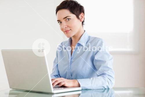 Charming businesswoman with a laptop