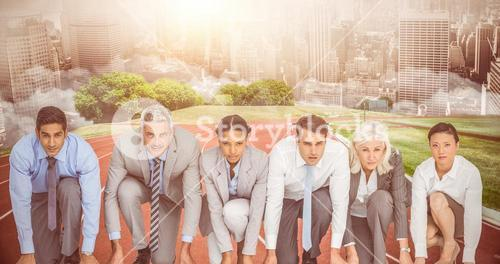 Composite image of business people preparing to run
