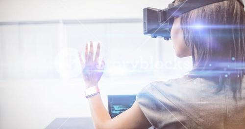 Businesswoman standing while using a virtual glasses