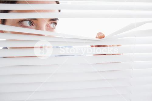 Woman peeking out of a window