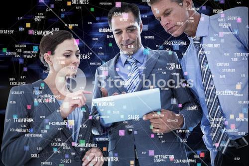 Composite image of businessman showing tablet to his colleagues