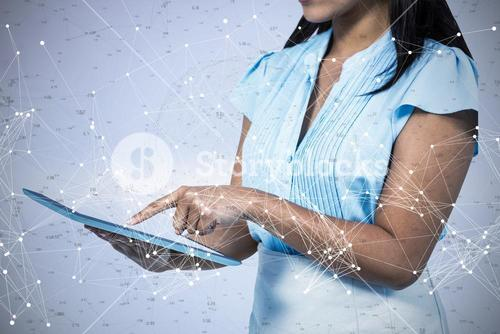 Composite image of cropped image of businesswoman using tablet