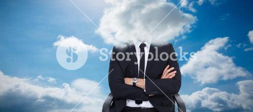 Composite image of serious businessman sitting with arms crossed