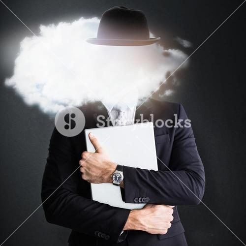 Composite image of mid section of businessman holding computer