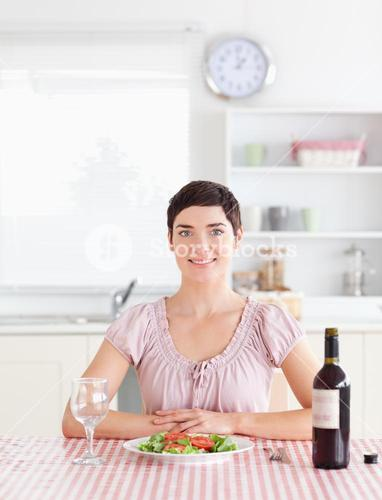 Cute Woman sitting at a table with wine for lunch