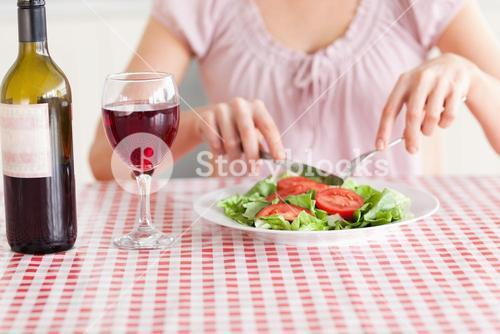 Cute Woman eating lunch and drinking wine