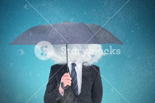 Composite image of unsmiling businessman sheltering under umbrella