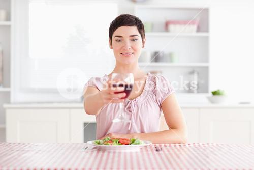 Woman toasting with wine
