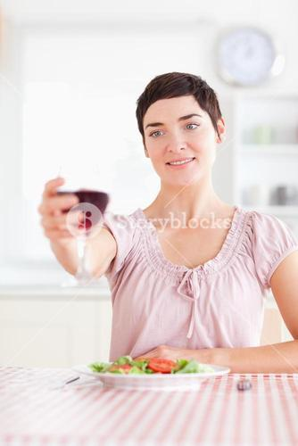 Charming Woman toasting with wine
