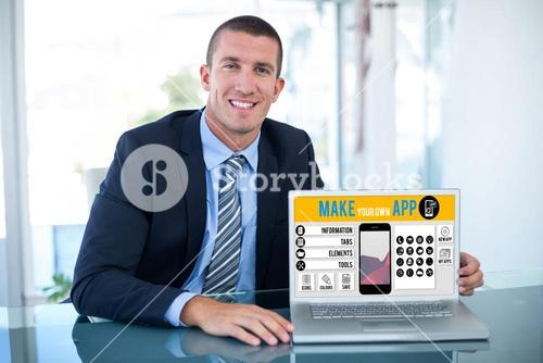 Composite image of portrait of smiling businessman showing laptop