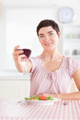 Gorgeous Woman toasting with wine