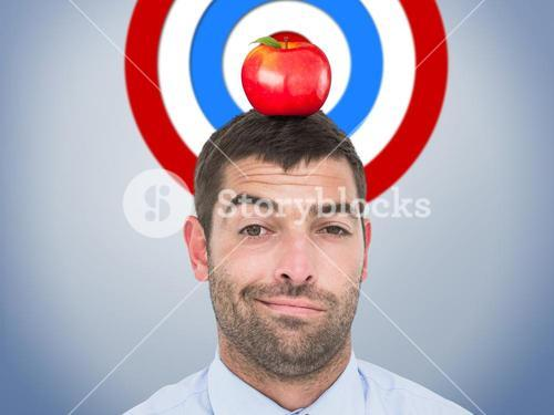 Composite image of businessman looking at the camera