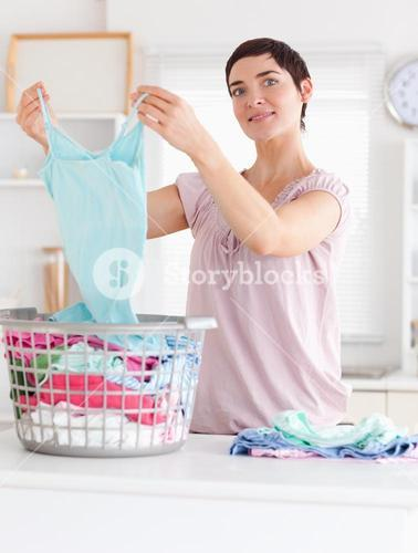 Charming Woman folding clothes