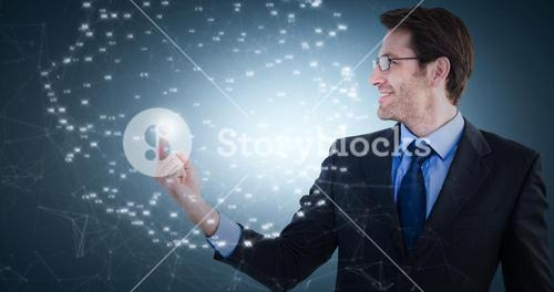 Composite image of smiling businessman pointing at a copy space