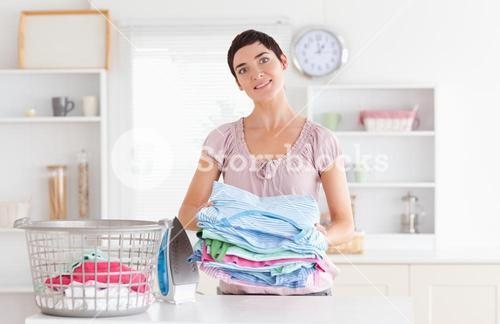 Woman with a pile of clothes